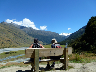 Rob Roy Glacier climbers pause in a bench and admire view