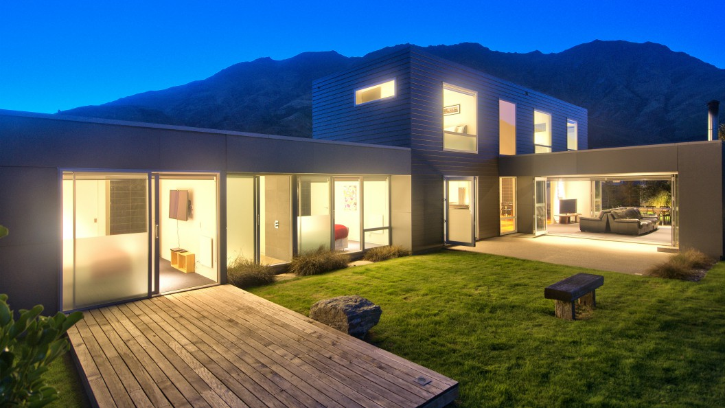 Arthurs Point luxury home Called Modern Family lit up at night