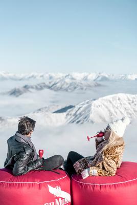 Cardrona Alpine Resort couple having a drink